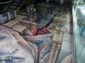 Malowidła przestrzenne na podłodze przy wejściu do Centrum Dziedzictwa Szkła.