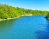 Zdjęcie wykonaliśmy z mostu między Pastwiskami, a Sieniawą na Jezioro Sieniawskie tworzone w tym miejscu przez Potok Czernisławka - tu też można spotkać sporo wędkarzy.