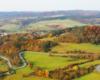 Serpentyny w Kulasznem z widokiem w stronę Szczawnego - zdjęcie wykonane podczas lotu paralotnią na pograniczu Bieszczad i Beskidu Niskiego.