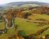 Kolory jesieni i serpentyny w Kulasznem widziane podczas lotu paralotnią nad Bieszczadami.